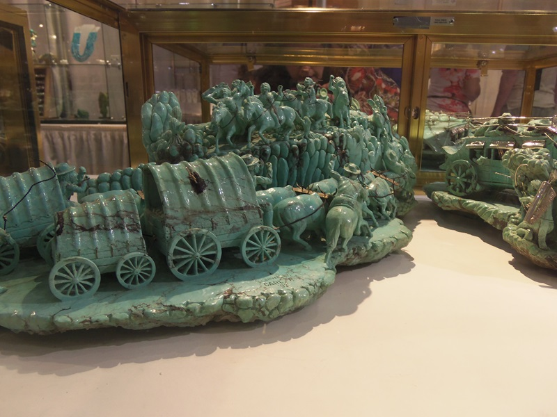Carved Turquoise depicting the beginning of the move West in the US.