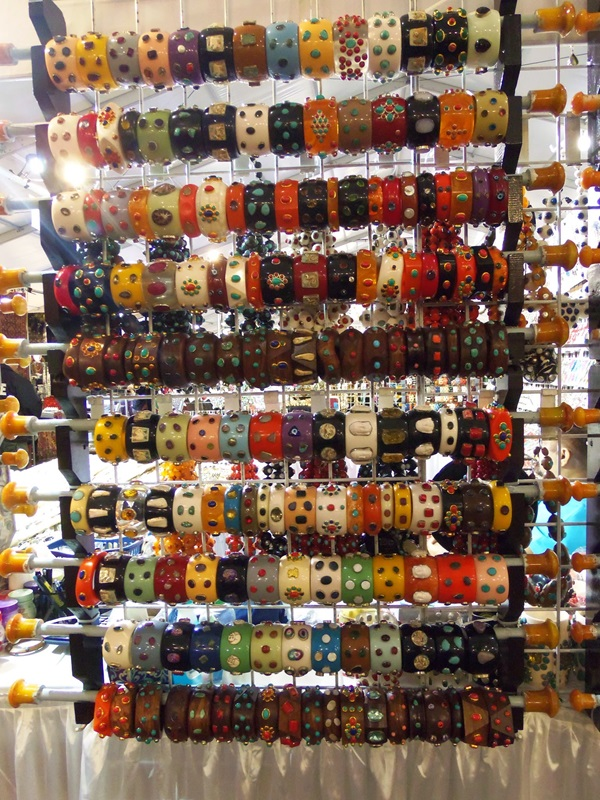 Don't  you love this colorful display of Bakelite bangles vivid colors and hand crafts that include handbags and apparel.