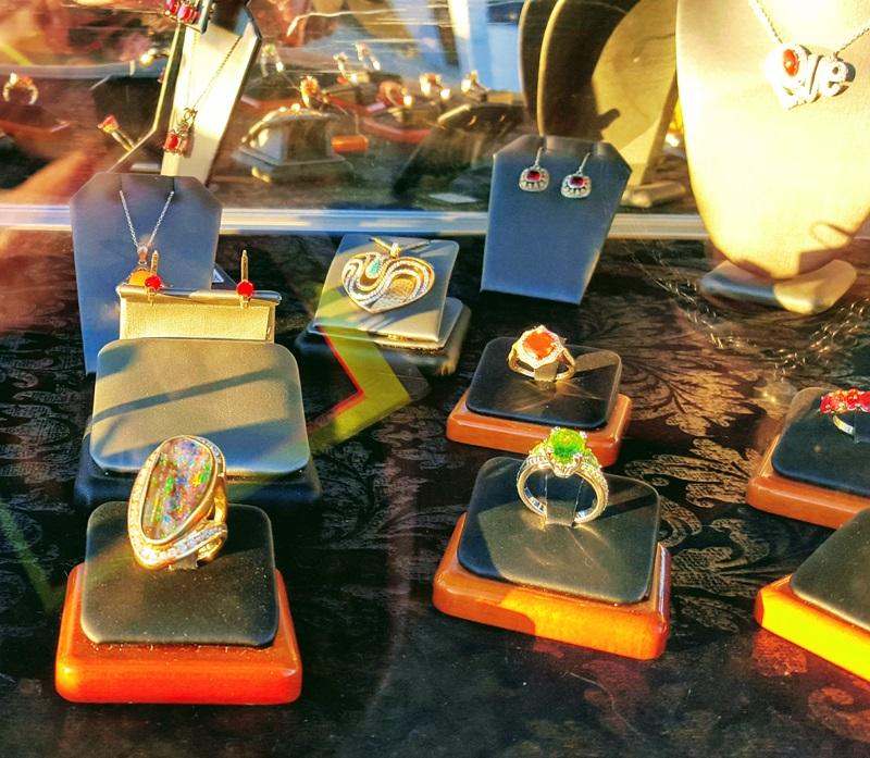 Beautiful Designs in Opal, Fire Opal and other gems. Vendor: Custom Creative Gem Cutting Photo: Robyn Hawk