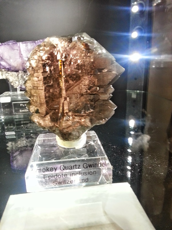 """Smokey Quartz Gwindel in the Pala International Collection at the Fine Mineral Show in the Denver Marriott West.  A fairly rare form of quartz, Gwindels or """"Twisted Quartz"""" are formations that are still not fully understood.  Denver Shows, Robyn Hawk"""